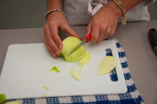 Cutting apples for mini apple tarts on eatlivetravelwrite.com