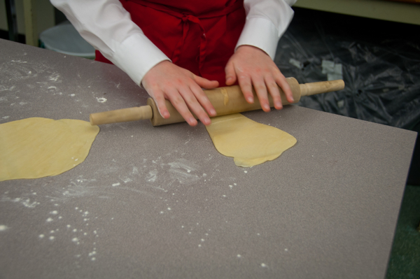 Rolling out puff pastry dough on eatlivetravelwrite.com