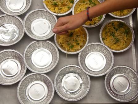 Scattering panko breadcrumbs on top of mac n cheese for Dish Do-Over Mac N Cheese on eatlivetravelwrite.com