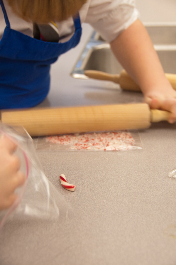 Kids smashing candy canes on eatlivetravelwrite.com