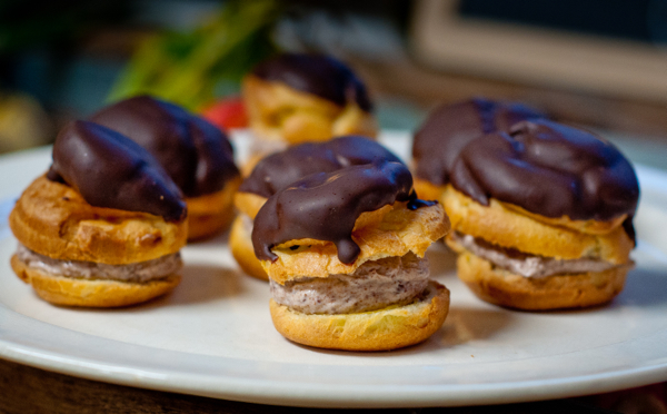 Profiteroles filled with chocolate coeur a la creme on eatlivetravelwrite.com