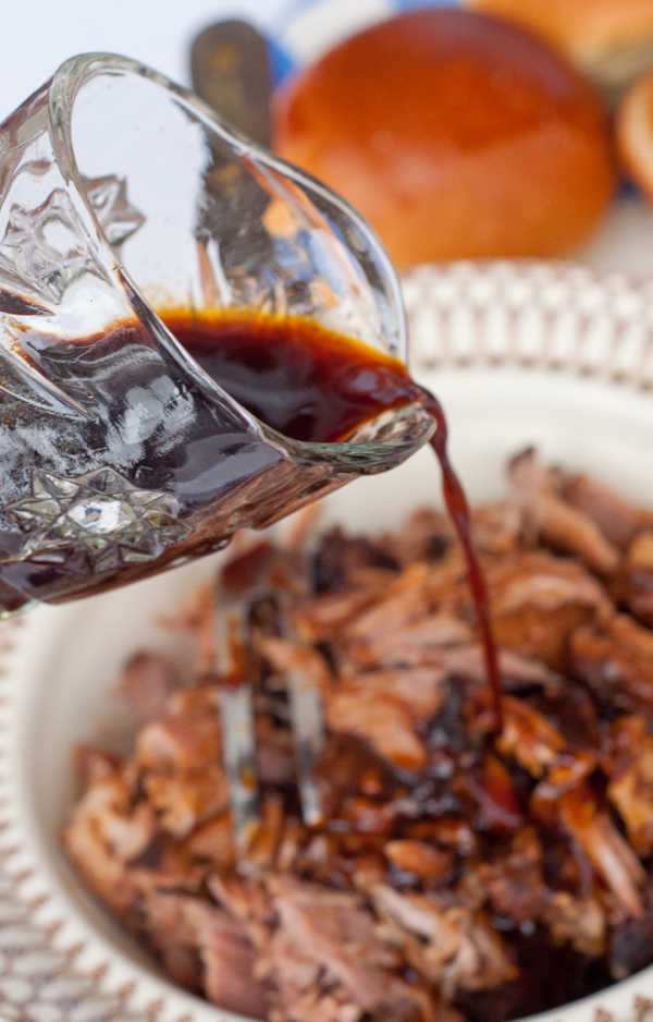 Pouring sauce on pulled pork on eatlivetravelwrite.com