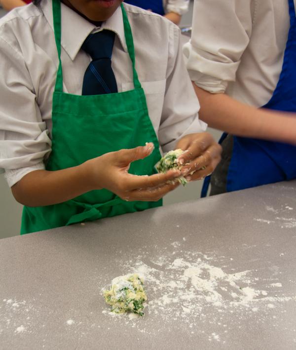 Forming kale gnocchi on eatlivetravelwrite.com