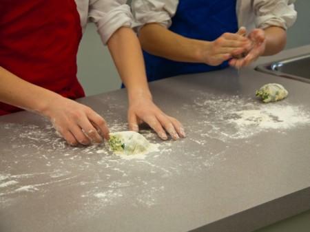 Kids assembling kale ricotta gnocchi on eatlivetravelwrite.com