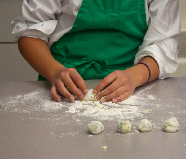 Kids using kale to make ricotta gnocchi on eatlivetravelwrite.com