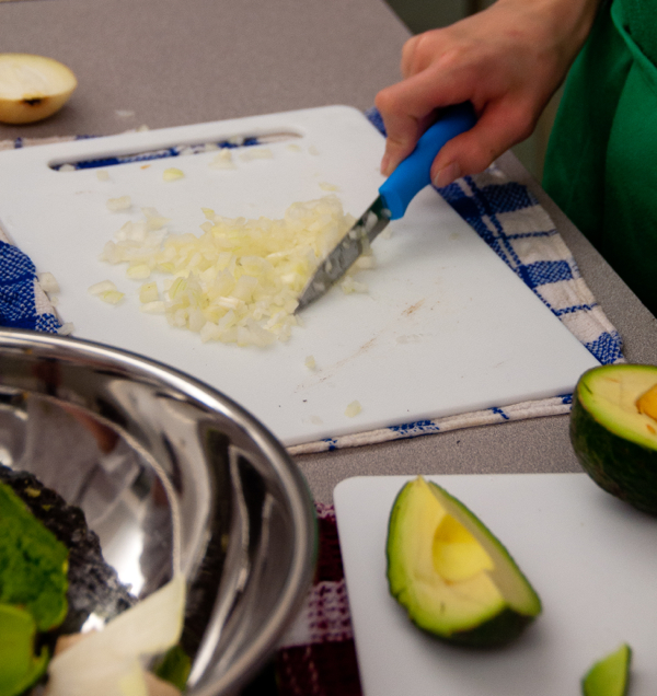 Kids chopping onions for guacamole on eatlivetravelwrite.com