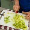 Kids chopping avocado for guacamole on eatlivetravelwrite.com