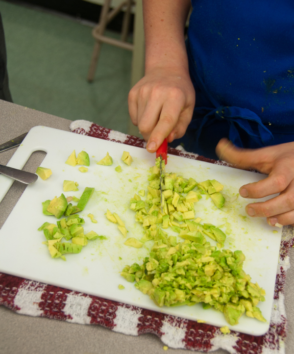 Kids chopping avocado for guacamole on eatlivetravelwrite.com