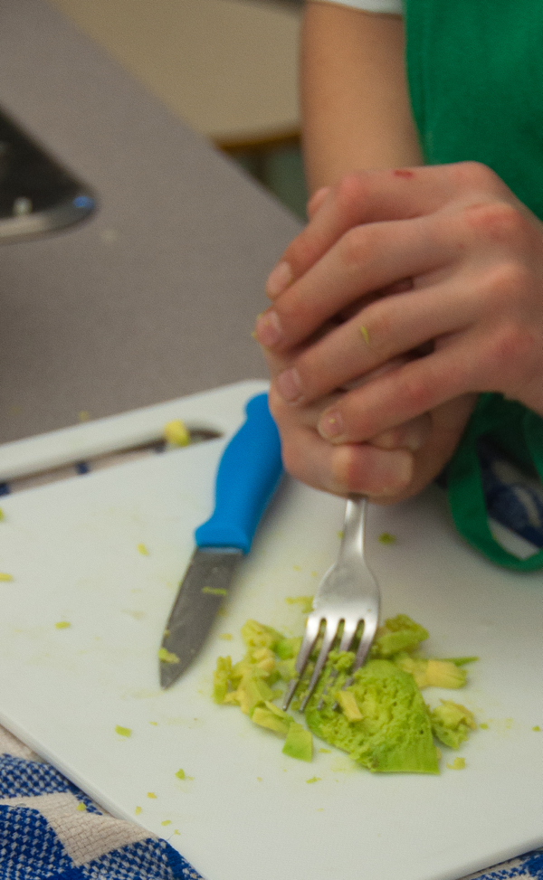 Using a fork to mash avocado on eatlivetravelwrite.com