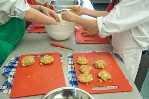 Kids making quinoa cakes from the 52 New Foods Challenge on eatlivetravelwrite.com