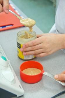 Kids making tahini on eatlivetravelwrite.com