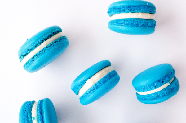 Blueberry macarons with cream cheese frosting filling on eatlivetravelwrite.com