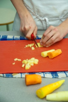 Kids cutting heirloom carrots on eatlivetravelwrite.com