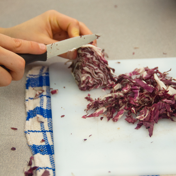 Cutting radicchio on eatlivetravelwrite.com