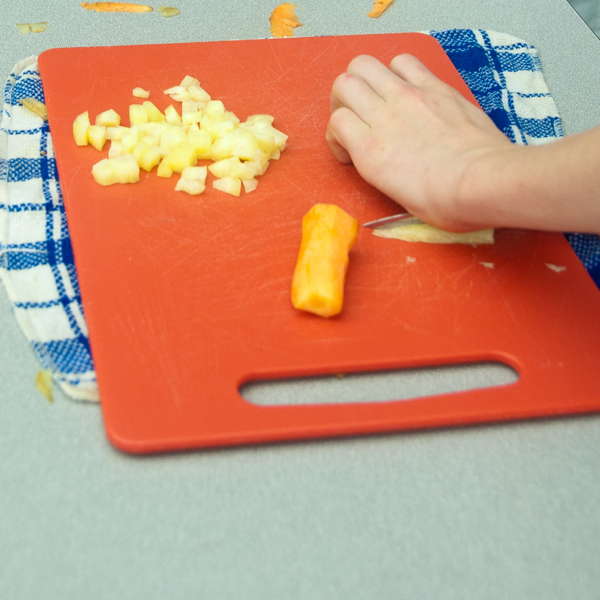 Kids cutting heirloom carrots into small dice on eatlivetravelwrite.com