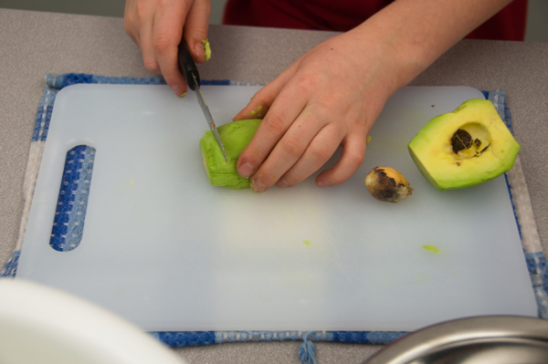 Kids slicing avocadoes on eatlivetravelwrite.com
