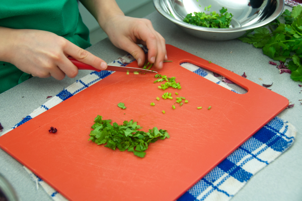 Kids chopping cilantro on eatlivetravelwrite.com