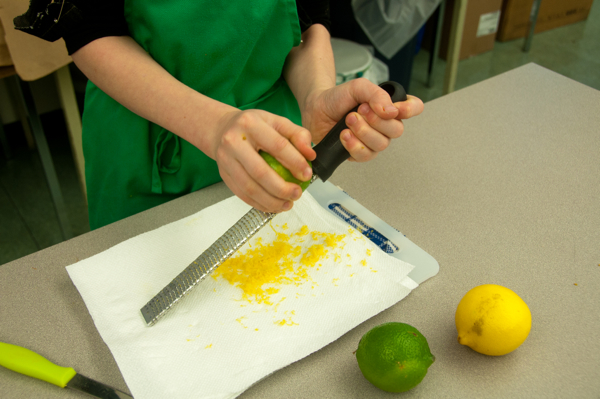 Kids zesting lime and lemons on eatlivetravelwrite.com