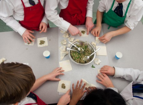 Kids working together to make dumplings on eatlivetravelwrite.com