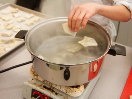 Kids boiling dumplings on eatlivetravelwrite.com