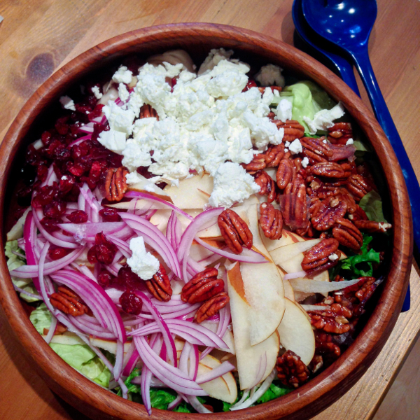 Pear, red onion, goat cheese and caramelized pecan salad from Gatherings on eatlivetravelwrite.com