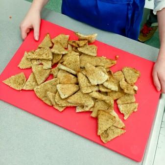 Kids making pita bread chips on eatlivetravelwrite.com