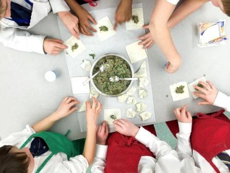 Kids making dumplings for Chinese New year on eatlivetravelwrite.com