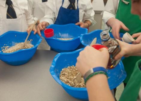 Kids measuring maple syrup on eatlivetravelwrite.com