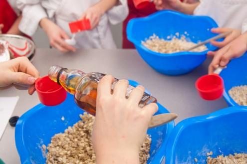 Measuring maple syrup for granola bars on eatlivetravelwrite.com