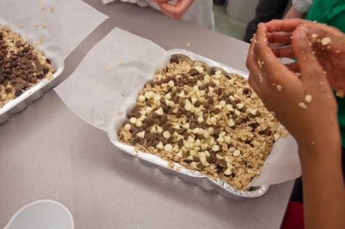 KIds getting granola bars ready for the oven on eatlivetravelwrite.com