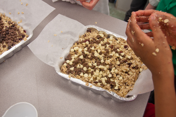 KIds getting granola bars ready for the oven on eatlivetravelwrite.com