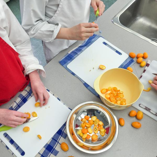 Kids chopping kumquats on eatlivetravelwrite.com