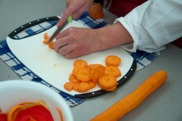 Kids chopping carrots on eatlivetravelwrite.com