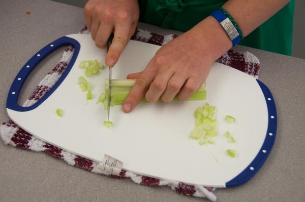 Kids chopping celery on eatlivetravelwrite.com