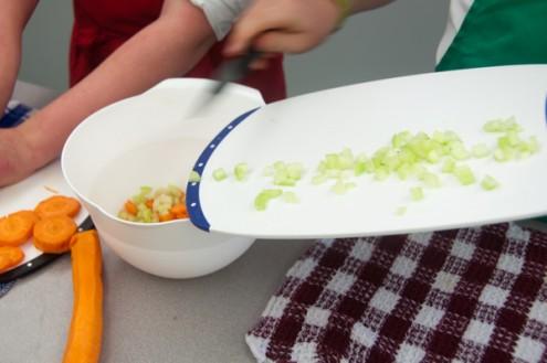 Kids making bolognese sauce on eatlivetravelwrite.com