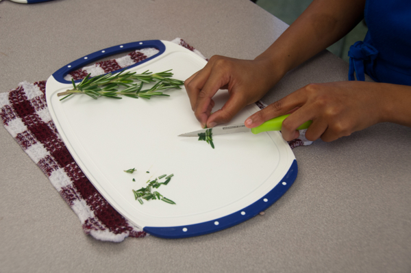Kids chopping rosemary on eatlivetravelwrite.com