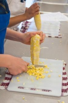 Kids working with corn on the cob Kids getting corn off the cob on eatlivetravelwrite.com