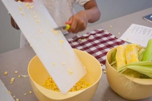 Kids in the kitchen making friend rice Kids getting corn off the cob on eatlivetravelwrite.com