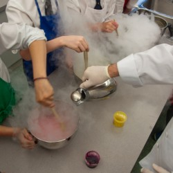 Kids mixing liquid nitrogen ice cream on eatlivetravelwrite.com