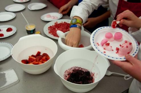 Kids plating berries in textures on eatlivetravelwrite.com