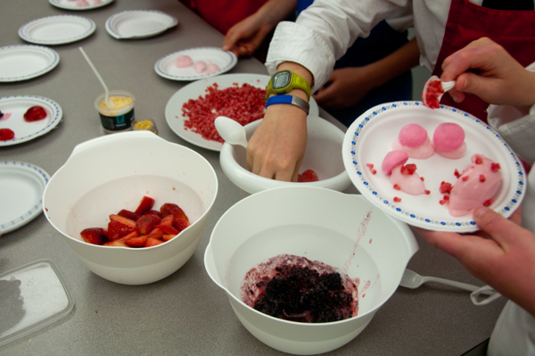Kids plating berries in textures on eatlivetravelwrite.com