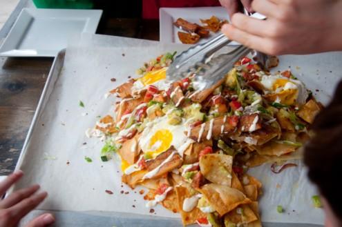 Kids serving bacon and egg nachos on eatlivetravelwrite.com