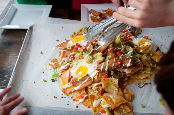 Kids serving bacon and egg nachos on eatlivetravelwrite.com