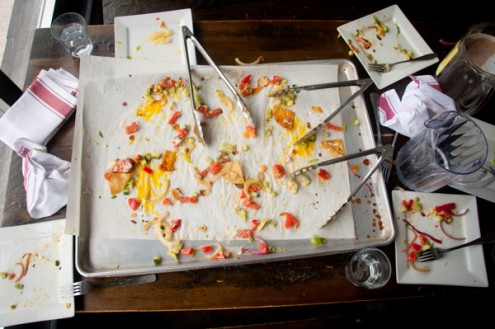 The bacon and egg nacho aftermath on eatlivetravelwrite.com