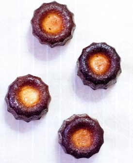 Caneles made in silicone moulds with butter coating on eatlivetravelwrite.com