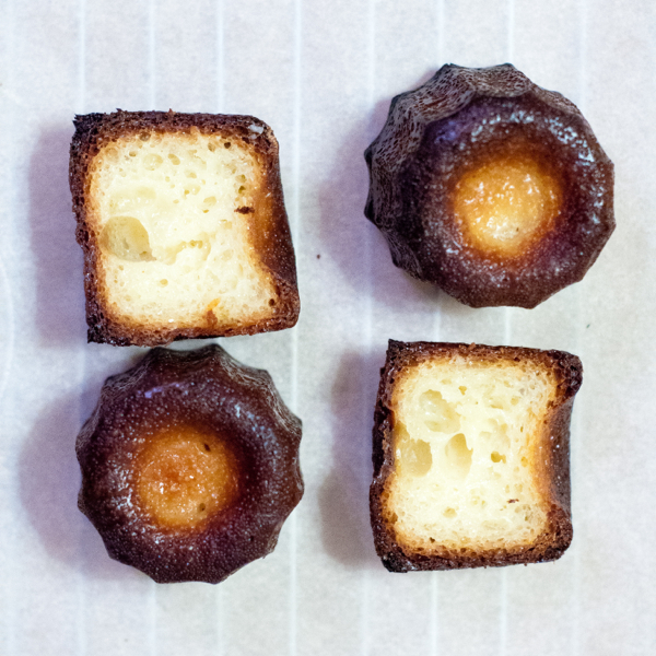 Interior view of Caneles made in silicone moulds with butter coating on eatlivetravelwrite.com