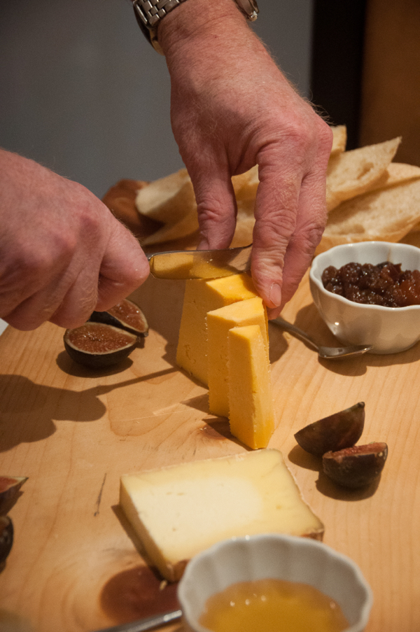 Learning how to cut cheese properly at Pangaea Restaurant on eatlivetravelwrite.com