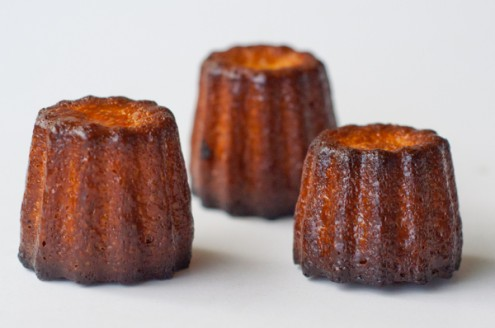 Caneles made in a Mastrad mold brushed with melted butter on eatlivetravelwrite.com