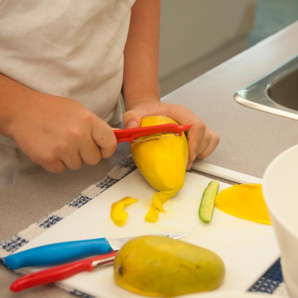 Kids peeling mango on eatlivetravelwrite.com