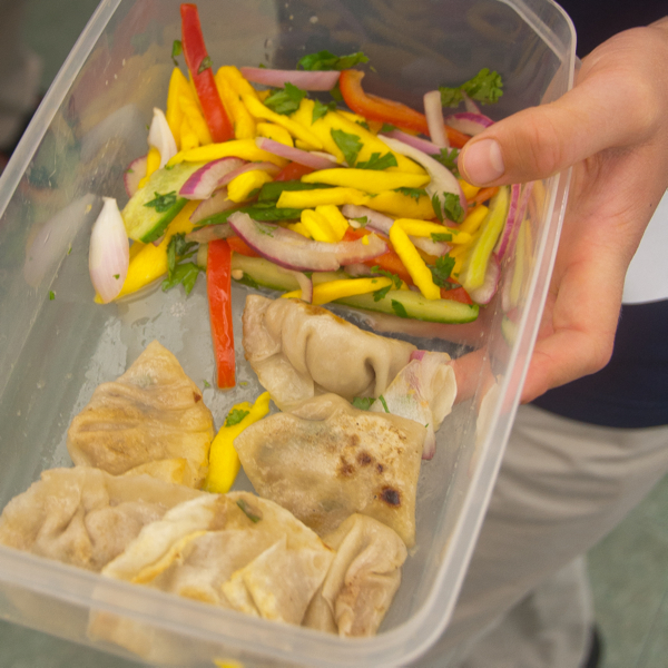 Kids make ginger chicken potstickers and mango salad on eatlivetravelwrite.com